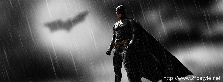 Batman-standing-on-a-roof-with-the-batman-sign-in-the-sky
